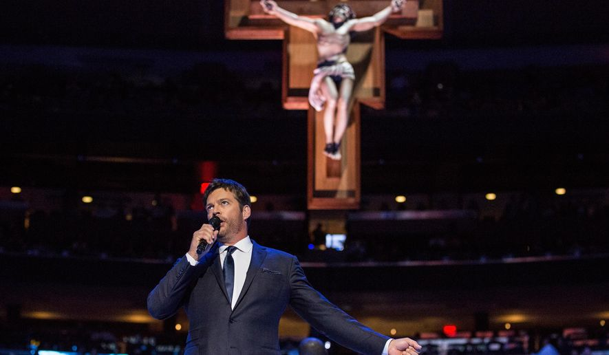 """Harry Connick Jr. sings """"How Great Thou Art"""" prior to a Mass led by Pope Francis at Madison Square Garden Friday, Sept. 25, 2015 in New York. Pope Francis is visiting New York City during a six-day tour of the United States, with stops in Washington D.C., New York City and Philadelphia.  (Andrew Burton/Pool Photo via AP)"""