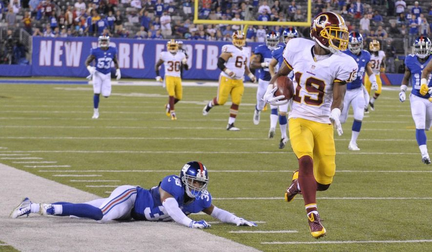 Washington Redskins' Rashad Ross (19) breaks a tackle by New York Giants' Trumaine McBride (38) on a kick return for a touchdown during the second half an NFL football game against the New York Giants Thursday, Sept. 24, 2015, in East Rutherford, N.J. (AP Photo/Bill Kostroun)
