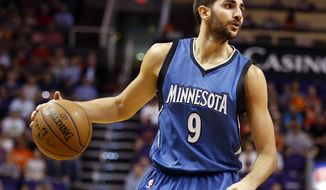 FILE - In this March 11, 2015, file photo, Minnesota Timberwolves guard Ricky Rubio (9) drives against the Phoenix Suns in the first quarter during an NBA basketball game in Phoenix. As the Timberwolves prepare to open training camp, Rubio finds himself at the center of trade rumors. (AP Photo/Rick Scuteri, File)