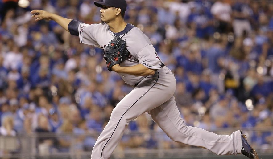 Cleveland Indians starting pitcher Carlos Carrasco throws during the first inning of a baseball game against the Kansas City Royals on Friday, Sept. 25, 2015, in Kansas City, Mo. (AP Photo/Charlie Riedel)