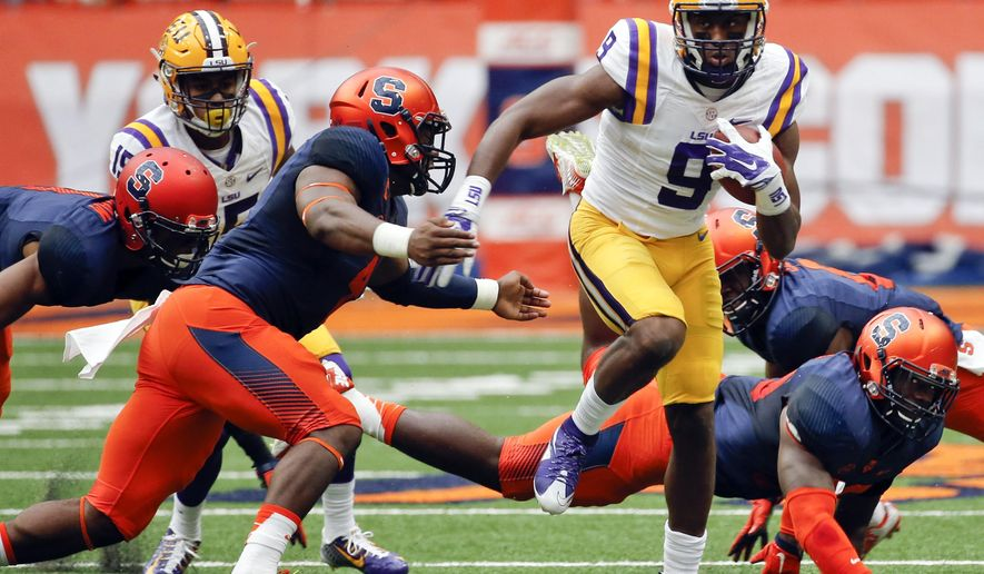 LSU wide receiver John Diarse (9) carries the ball as Syracuse linebacker Zaire Franklin (4) closes in during the first half of an NCAA college football game on Saturday, Sept. 26, 2015, in Syracuse, N.Y. (AP Photo/Mike Groll)