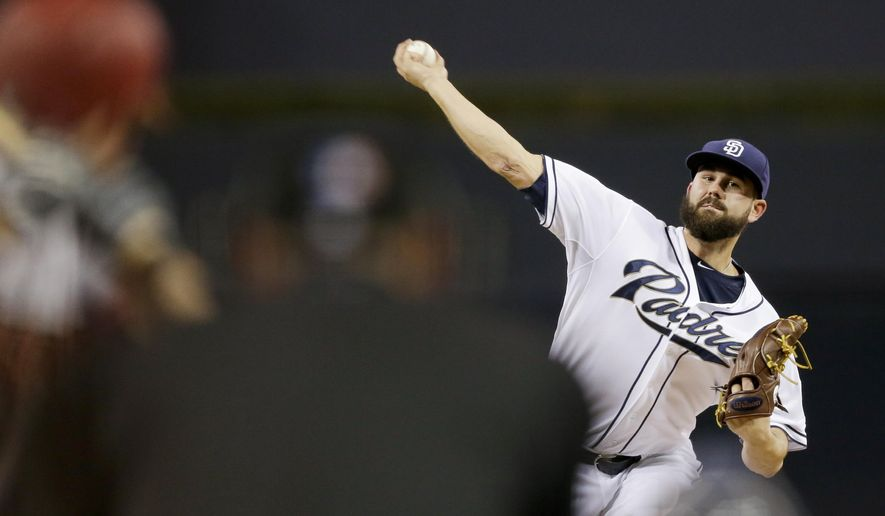 San Diego Padres starting pitcher Casey Kelly works against an Arizona Diamondbacks batter during the first inning of a baseball game Friday, Sept. 25, 2015, in San Diego. (AP Photo/Gregory Bull)