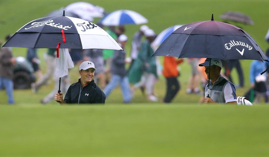 Jordan Spieth, left, shares a laugh with Henrik Stenson while they walk down the ninth fairway during the third round of the Tour Championship golf tournament at East Lake Golf Club, Saturday, Sept. 26, 2015, in Atlanta. (Curtis Compton/Atlanta Journal-Constitution via AP)  MARIETTA DAILY OUT; GWINNETT DAILY POST OUT; LOCAL TELEVISION OUT; WXIA-TV OUT; WGCL-TV OUT; MANDATORY CREDIT