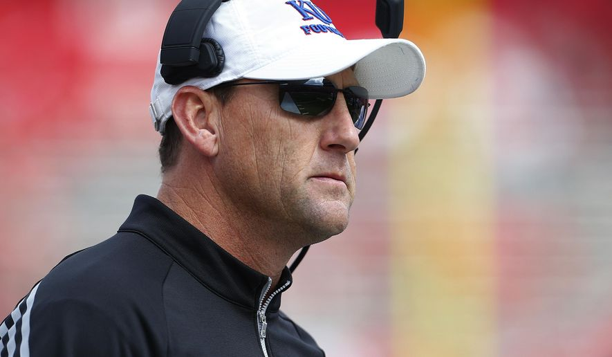 Kansas head coach David Beaty looks on from the sidelines during the first quarter against Rutgers in an NCAA college football game Saturday, Sept. 27, 2015, in Piscataway, N.J. Rutgers won 27-14. (AP Photo/Rich Schultz)