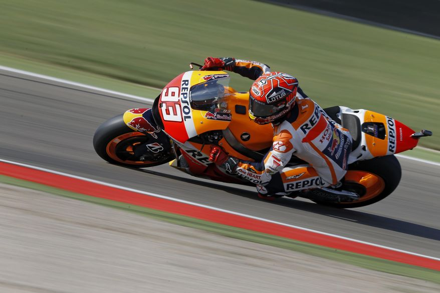 MotoGP rider Marc Marquez of Spain leans into a curve with his Honda during the third free practice session for Sunday's Spain MotoGP Motorcycle Grand Prix at the Aragon Motorland racetrack in Alcaniz, Spain, Saturday, Sept. 26, 2015. Marquez clocked the fastest time during the qualifying session. (AP Photo/Francisco Seco)