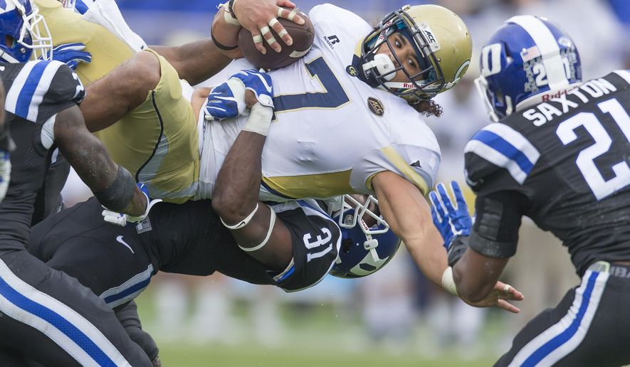 Georgia Tech's Patrick Skov (7) is brought down by Duke's Breon Borders after picking up a first down during the second half of an NCAA college football game, in Durham, N.C., Saturday, Sept. 26, 2015. Duke won 34-20. (AP Photo/Rob Brown)