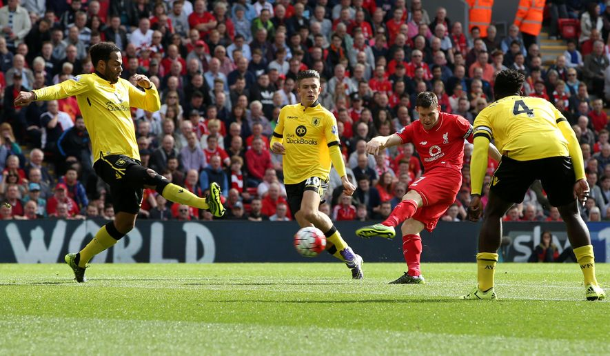 Liverpool's James Milner, second right, scores the first goal of the game during their English Premier League soccer match against Aston Villa at Anfield, Liverpool, England, Saturday, Sept. 26, 2015. (Peter Byrne/PA via AP)     UNITED KINGDOM OUT      -     NO ARCHIVES    -    NO SALES