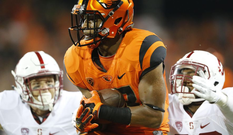 Oregon State's Jordan Villamin cradles a touchdown pass during the second half of an NCAA college football game against Stanford, in Corvallis, Ore., Friday, Sept. 25, 2015. (AP Photo/Timothy J. Gonzalez)
