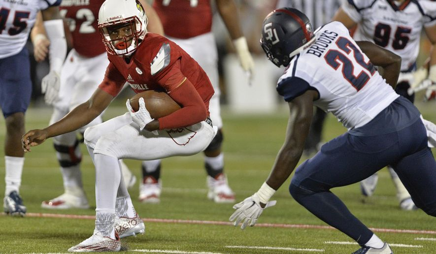 Louisville quarterback Lamar Jackson (8) looks to get away from Samford defensive back Cody Brooks (22) during the second half of an NCAA college football game Saturday, Sept. 26, 2015, in Louisville, Ky. Louisville won 45-3. (AP Photo/Timothy D. Easley)