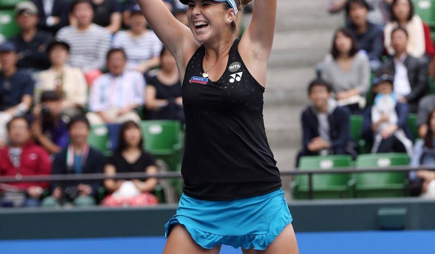 Belinda Bencic of Switzerland celebrates after defeating Caroline Wozniacki of Denmark during a semifinal match at the Pan Pacific Open women?s tennis tournament in Tokyo, Saturday, Sept. 26, 2015. (AP Photo/Eugene Hoshiko)