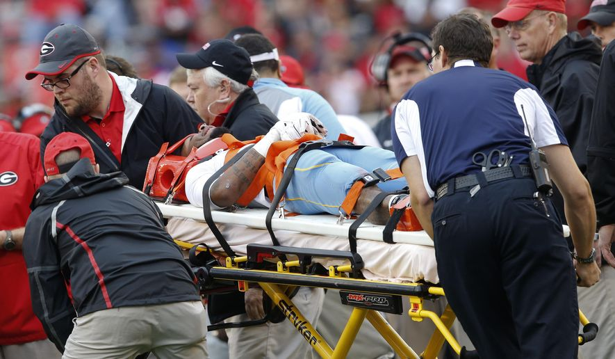 Southern wide receiver Devon Gales (33) is taken off the field after he was injured in the second half of an NCAA college football game against Georgia  Saturday, Sept. 26, 2015, in Athens, Ga. (AP Photo/John Bazemore)