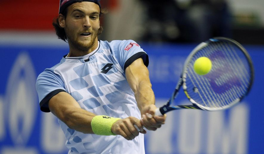 Joao Sousa of Portugal returns the ball to Dominic Thiem of Austria during the St. Petersburg Open ATP tennis tournament semifinal match in St. Petersburg, Russia, Saturday, Sept. 26, 2015. (AP Photo/Dmitry Lovetsky)