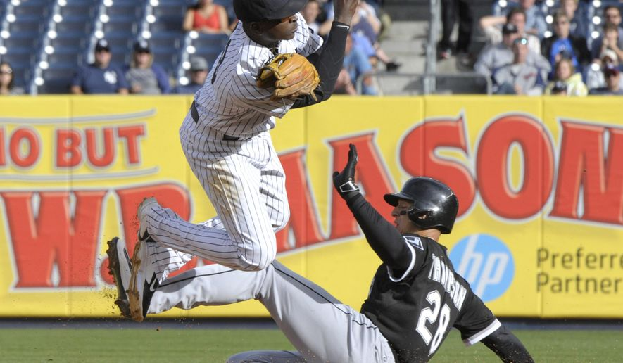 Chicago White Sox Trayce Thompson, right, is out at second as New York Yankees shortstop Didi Gregorius relays the ball to first to complete the double play on White Sox's Adam LaRoche during the first inning of a baseball game Saturday, Sept. 26, 2015, at Yankee Stadium in New York. (AP Photo/Bill Kostroun)