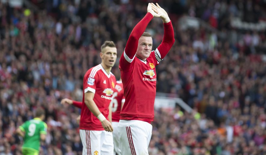Manchester United's Wayne Rooney celebrates after scoring during the English Premier League soccer match between Manchester United and Sunderland at Old Trafford Stadium, Manchester, England, Saturday, Sept. 26, 2015. (AP Photo/Jon Super)