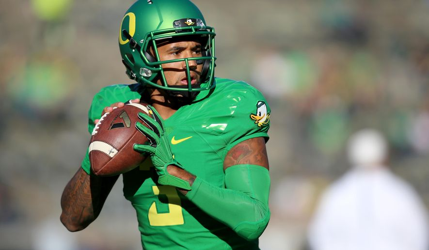 Oregon quarterback Vernon Adams Jr. (3) warms up before the start of an NCAA college football game against Utah, Saturday, Sept. 26, 2015, in Eugene, Ore. (AP Photo/Ryan Kang)