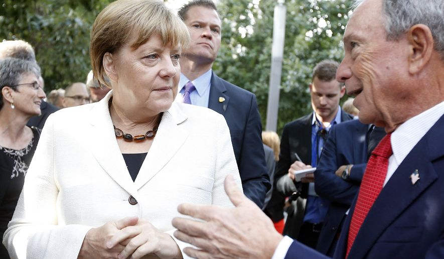 German Chancellor Angela Merkel converses with former New York Mayor Michael Bloomberg during a tour of the 9/11 Memorial, Saturday, Sept. 26, 2015, in New York. (AP Photo/Jason DeCrow)