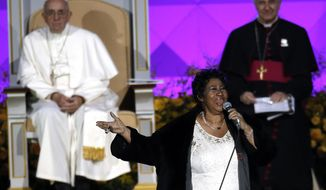 Aretha Franklin performs as Pope Francis is seated behind her during the Festival of Families, Saturday, Sept. 26, 2015, in Philadelphia. (AP Photo/Matt Slocum)