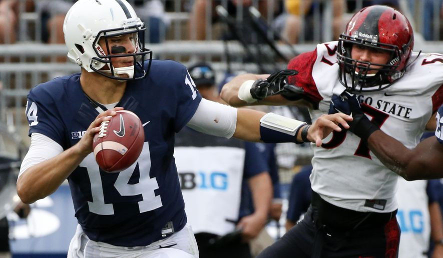 Penn State Nittany Lions quarterback Christian Hackenberg (14) looks to pass under pressure from San Diego State linebacker Ryan Dunn (57) during the first half of an NCAA college football game in State College, Pa., Saturday, Sept. 26, 2015. (AP Photo/Gene J. Puskar)