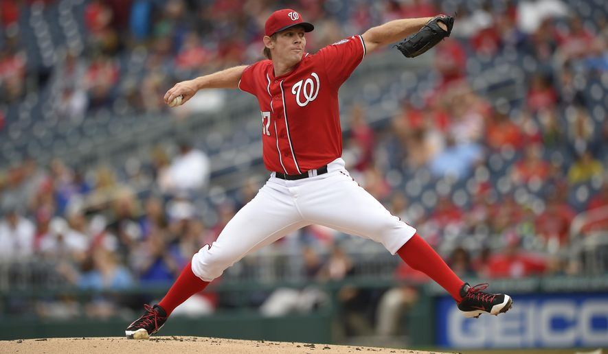 Washington Nationals starting pitcher Stephen Strasburg (37) delivers a pitch against the Philadelphia Phillies during the first inning of a baseball game, Saturday, Sept. 26, 2015, in Washington. (AP Photo/Nick Wass)