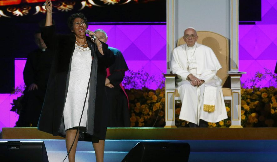 American singer Aretha Franklin sings as Pope Francis and others listen during the World Meeting of Families festival in Philadelphia, Saturday, Sept. 26, 2015. (Tony Gentile/Pool Photo via AP)