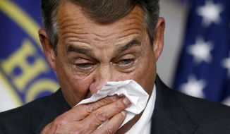 House Speaker John Boehner of Ohio wipes his face during a news conference on Capitol Hill  in Washington, Friday, Sept. 25, 2015. In a stunning move, Boehner informed fellow Republicans on Friday that he would resign from Congress at the end of October, stepping aside in the face of hardline conservative opposition that threatened an institutional crisis. (AP Photo/Steve Helber)