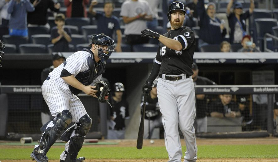 New York Yankees catcher Brian McCann, left, reacts as Chicago White Sox's Adam LaRoche strikes out to end a baseball game Saturday, Sept. 26, 2015, at Yankee Stadium in New York. The Yankees defeated the White Sox 2-1. (AP Photo/Bill Kostroun)