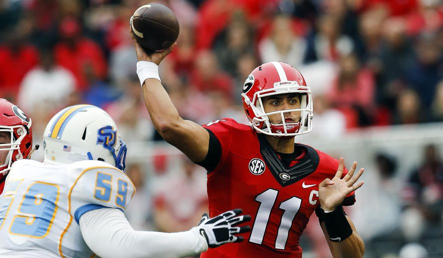 Georgia quarterback Greyson Lambert (11) throw under pressure from Southern defensive lineman Christopher Jones (59) in the first half of an NCAA college football game  Saturday, Sept. 26, 2015, in Athens, Ga. (AP Photo/John Bazemore)