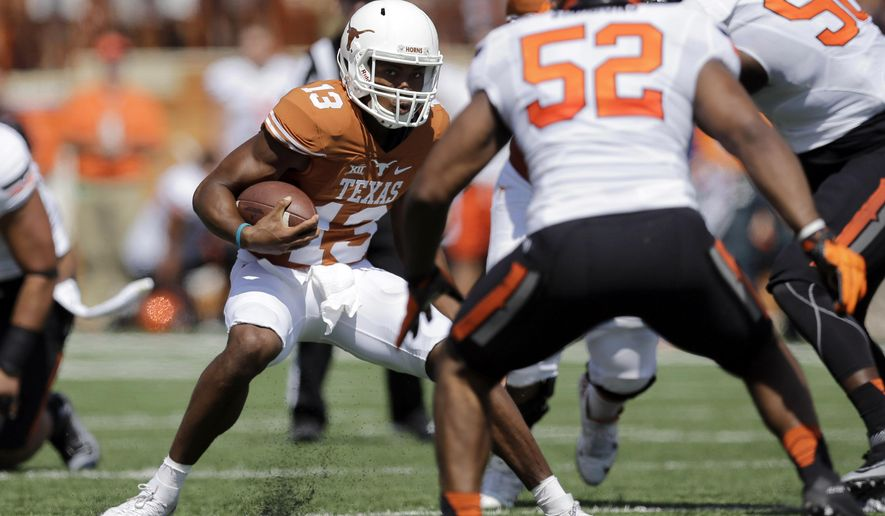 Texas' Jerrod Heard (13) scrambles against Oklahoma State during the first half of an NCAA college football game, Saturday, Sept. 26, 2015, in Austin, Texas. (AP Photo/Eric Gay)