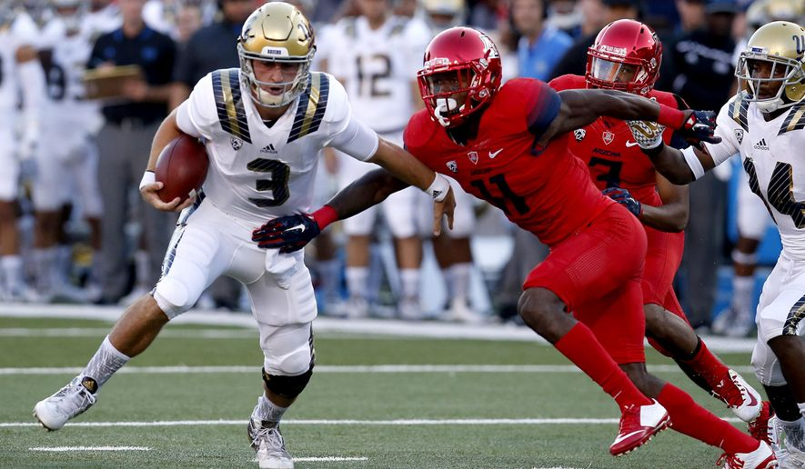 UCLA quarterback Josh Rosen (3) gets away from Arizona safety Will Parks during the first half of an NCAA college football game, Saturday, Sept. 26, 2015, in Tucson, Ariz. (AP Photo/Rick Scuteri)