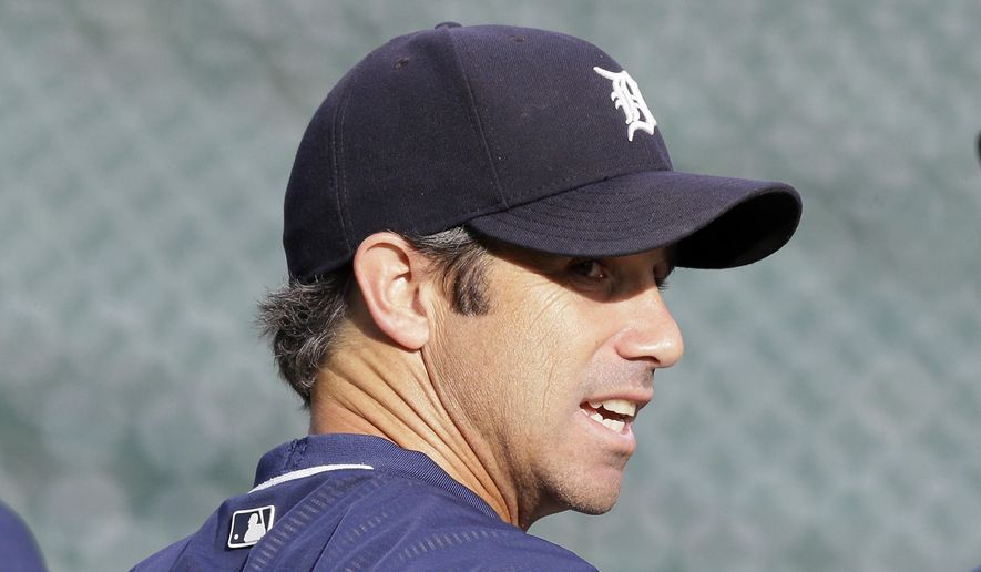 Detroit Tigers manager Brad Ausmus watches batting practice before the game against the Minnesota Twins, Saturday, Sept. 26, 2015 in Detroit. Ausmus is going to return as the Detroit Tigers' manager in 2016. General manager Al Avila made the announcement Saturday despite reports that the decision had already been made to fire second year manager. Avila said he understood Ausmus was dealing with severe roster limitations as the Tigers dropped to last in the AL Central after four straight division titles. (AP Photo/Carlos Osorio)