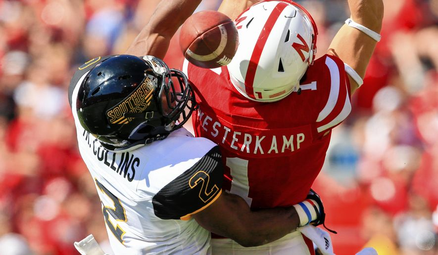 Southern Miss defensive back Trae Collins (2) breaks up a pass intended for Nebraska wide receiver Jordan Westerkamp (1) during the second half of an NCAA college football game in Lincoln, Neb., Saturday, Sept. 26, 2015. Nebraska won 36-28. (AP Photo/Nati Harnik)
