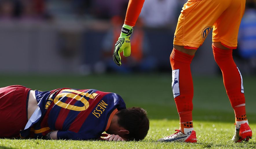 FC Barcelona's Lionel Messi reacts after getting injured during a Spanish La Liga soccer match against Las Palmas at the Camp Nou stadium in Barcelona, Spain, Saturday, Sept. 26, 2015. (AP Photo/Manu Fernandez)