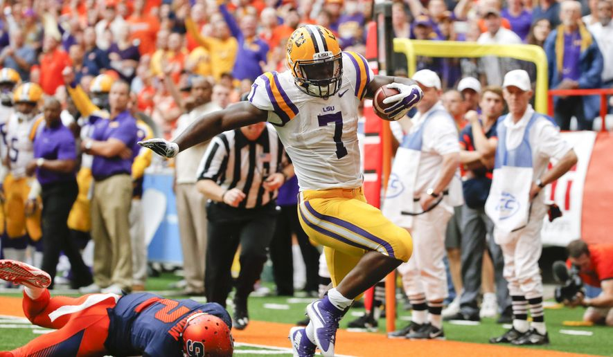 LSU running back Leonard Fournette (7) gets past Syracuse cornerback Wayne Morgan (2) for a touchdown in the first half of an NCAA college football game, Saturday, Sept. 26, 2015, in Syracuse, N.Y. (AP Photo/Mike Groll)