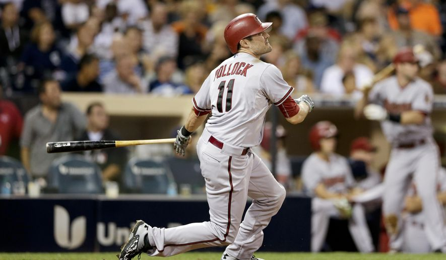 Arizona Diamondbacks' A.J. Pollock watches his grand slam against the San Diego Padres during the second inning of a baseball game Friday, Sept. 25, 2015, in San Diego. (AP Photo/Gregory Bull)