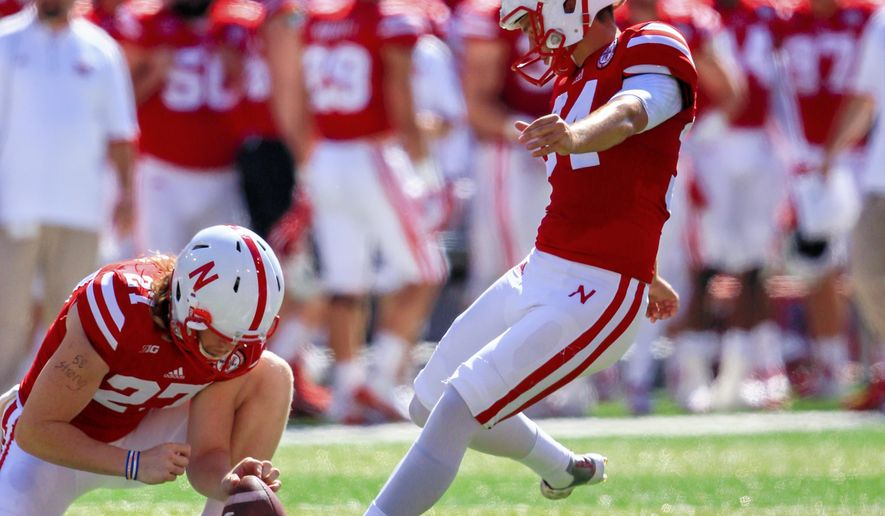 Nebraska kicker Drew Brown (34) kicks a field goal with Sam Foltz (27) holding during the first half of an NCAA college football game against Southern Miss in Lincoln, Neb., Saturday, Sept. 26, 2015. (AP Photo/Nati Harnik)
