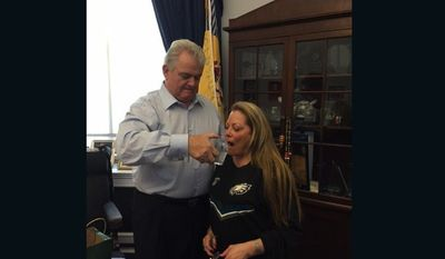 U.S. Rep. Bob Brady (D-Pa.) and his wife take turns sipping 'holy water' from a glass used by Pope Francis during his address to Congress. (Image: Officer of Rep. Congressman Bob Brady)