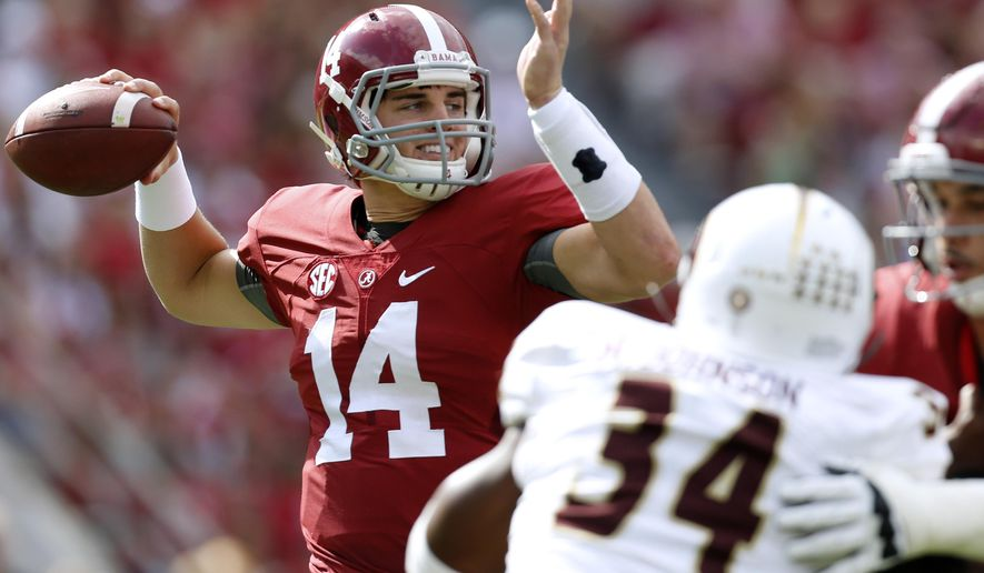 Alabama quarterback Jake Coker (14) throws a pass during the first half of an NCAA college football game against Louisiana Monroe in Tuscaloosa, Ala., Saturday, Sept. 26, 2015. (AP Photo/Jonathan Bachman)