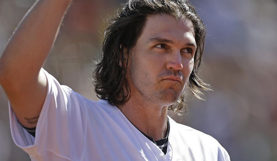 Oakland Athletics pitcher Barry Zito waves to fans as he leaves the baseball game against the San Francisco Giants in the third inning of a baseball game Saturday, Sept. 26, 2015, in Oakland, Calif. (AP Photo/Ben Margot)