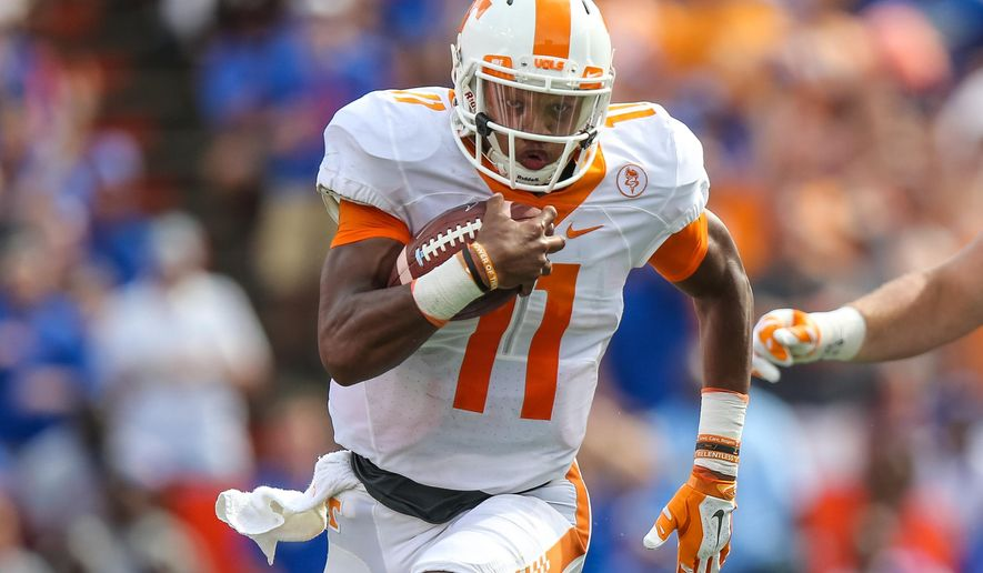 Tennessee quarterback Joshua Dobbs (11) runs the ball for a touchdown after a catch against Florida during the first half in an NCAA college football game, Saturday, Sept. 26, 2015 in Gainesville, Fla. (AP Photo/Gary McCullough)