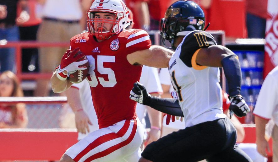 Nebraska fullback Andy Janovich (35) is pursued by Southern Miss defensive back Kalan Reed (11) during the first half of an NCAA college football game in Lincoln, Neb., Saturday, Sept. 26, 2015. (AP Photo/Nati Harnik)