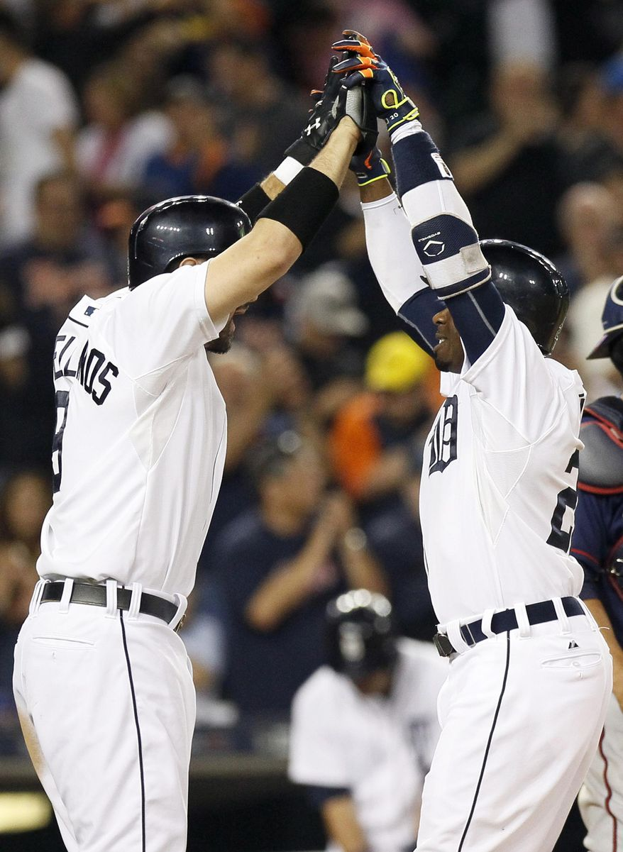 Detroit Tigers' Rajai Davis, right, celebrates his two-run home run with teammate Nick Castellanos, left, during the eighth inning of a baseball game against the Minnesota Twins at Comerica Park, Friday, Sept. 25, 2015, in Detroit. (AP Photo/Duane Burleson)