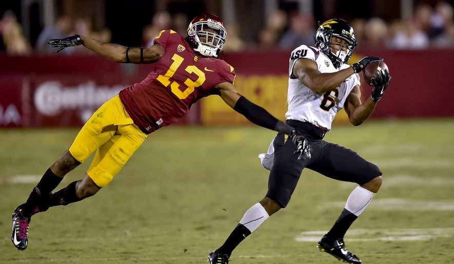 FILE - In this Oct. 4, 2014, file photo, Arizona State wide receiver Cameron Smith (6) gets by Southern California cornerback Kevon Seymour (13) on a touchdown reception during an NCAA college football game in Los Angeles. Arizona State has won two straight and three of four against the Trojans, but has never won three in a row in the series. The teams play Saturday, Sept. 26. (AP Photo/Gus Ruelas, File)
