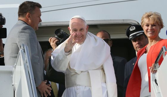Pope Francis waves to the hundreds of faithful who came to see him off as he prepares to depart John F. Kennedy International Airport on Saturday, Sept. 26, 2015 in New York. Pope Francis will spend the last two of his six days in the U.S. in Philadelphia.  (John Paraskevas/Newsday via AP, Pool)