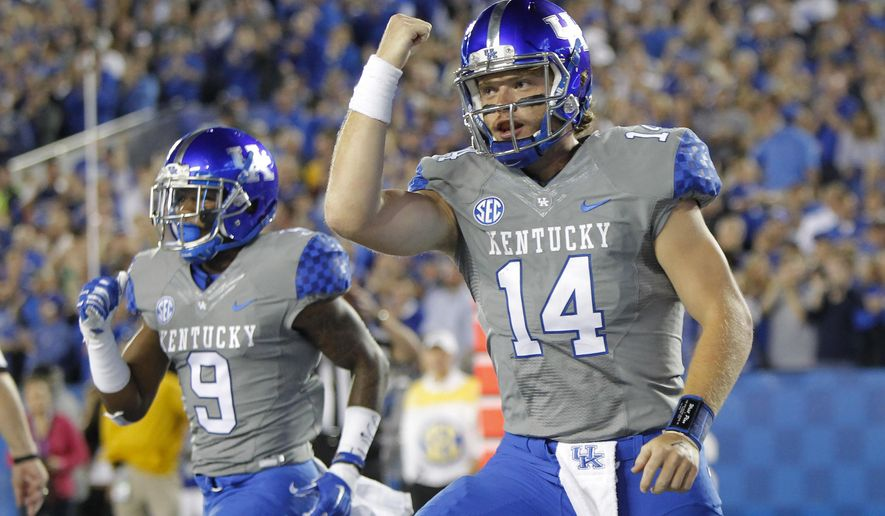 Kentucky quarterback Patrick Towles celebrates his touchdown run during the first half of an NCAA college football game against Missouri, Saturday, Sept. 26, 2015, in Lexington, Ky. (AP Photo/David Stephenson)