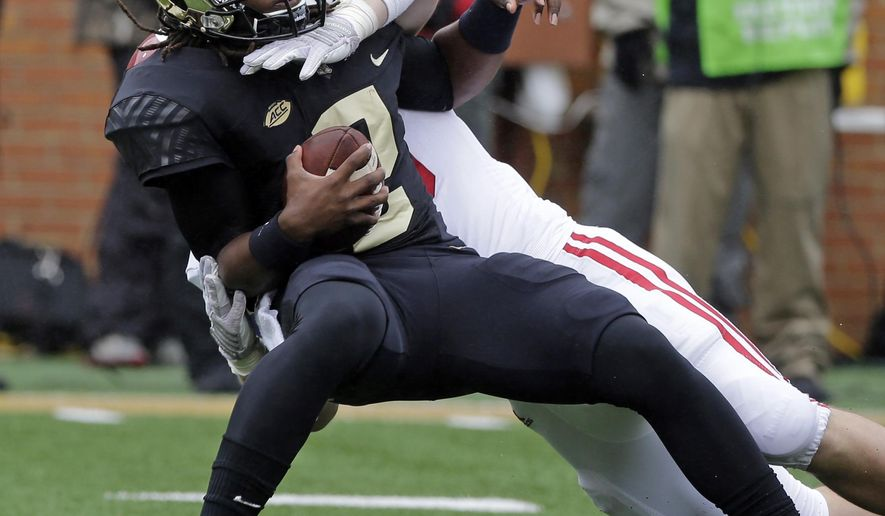Wake Forest's Kendall Hinton (2) is sacked by Indiana's Zack Shaw (33) during the first half of an NCAA college football game in Winston-Salem, N.C., Saturday, Sept. 26, 2015. (AP Photo/Chuck Burton)