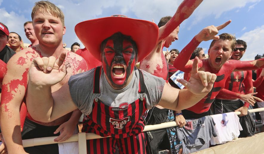 Texas Tech fans cheer in the stands during the first half of an NCAA college football game against TCU, Saturday, Sept. 26, 2015, in Lubbock, Texas. (AP Photo/LM Otero)