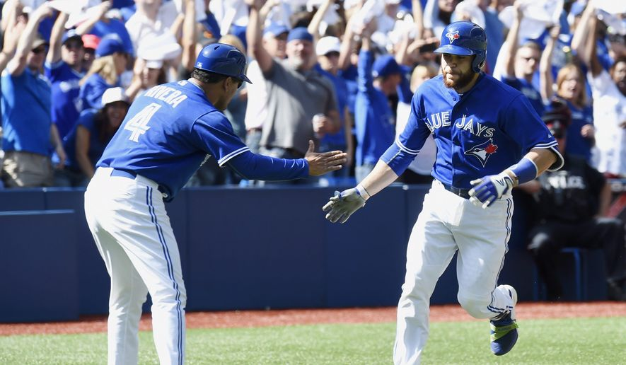 Toronto Blue Jays' Russell Martin, right, is congratulated following a two-run home run during first inning of a baseball game against the Tampa Bay Rays in Toronto, Saturday, Sept. 26, 2015. (Frank Gunn/The Canadian Press via AP) MANDATORY CREDIT