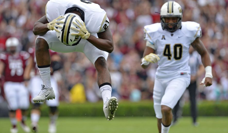 Central Florida's Drico Johnson, left,  reacts after missing an interception during the first half of an NCAA college football game against South Carolina, Saturday, Sept. 26, 2015,  in Columbia, S.C. (AP Photo/Richard Shiro)