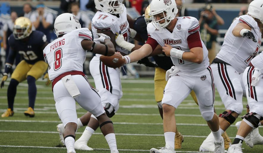Massachusetts 's Blake Frohnapfel (7) hands the ball off to Marquis Young during the first half of an NCAA college football game against Notre Dame Saturday, Sept. 26, 2015, in South Bend, Ind. (AP Photo/Charles Rex Arbogast)