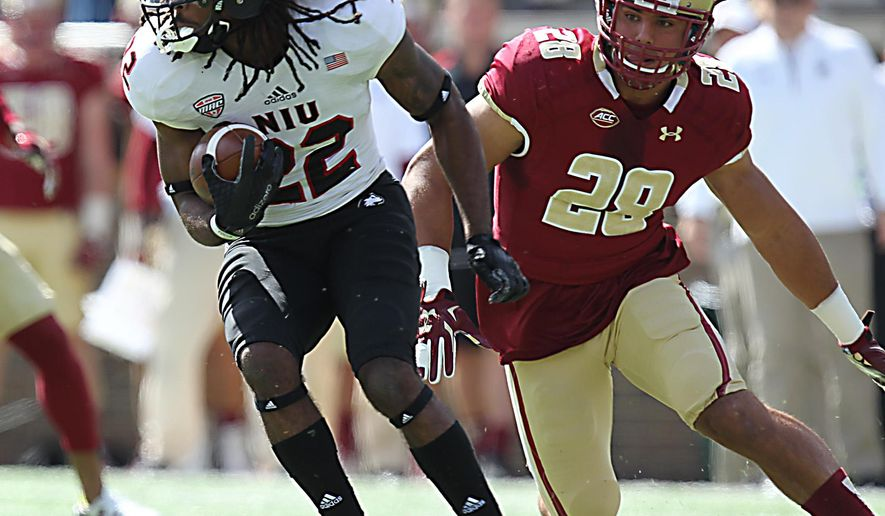 Boston College linebacker Matt Milano, right, chases down Northern Illinois wide receiver Aregeros Turner in the first quarter of an NCAA college football game at Alumni Stadium. Saturday, Sept. 26, 2015 in Chestnut Hill, Mass. (John Wilcox/The Boston Herald via AP)  BOSTON GLOBE OUT; METRO BOSTON OUT; MAGS OUT; ONLINE OUT; MANDATORY CREDIT